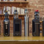 Electronic Cigarette On A Background Of Vape Shop